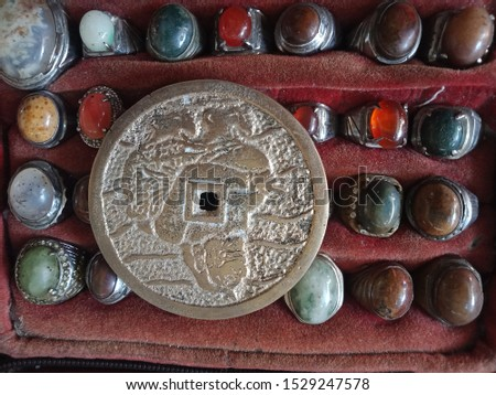 ancient coins on ancient agate