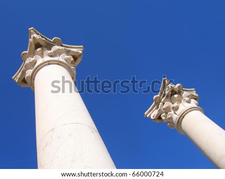 ancient columns of Greek temple on the background of sky