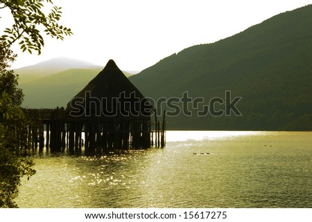 Ancient Crannog House, Loch Tay, Kenmore, Scotland at Sunset