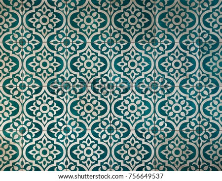 Ancient dark greenish blue and white tile pattern warn of buy time. #756649537