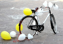 ancient decorated bicycle to make a joke to two future bride and groom just married