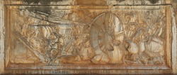 Ancient dirty and rusty relief with the scene of a medieval war, engraved in white stone - background wallpaper