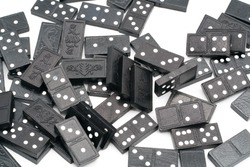 Ancient domino board games. Domino game pieces. Lots of game figures. Wooden chips. Black and white game. Numbers. Strategy game from ancient china. White background. Pile of pieces.