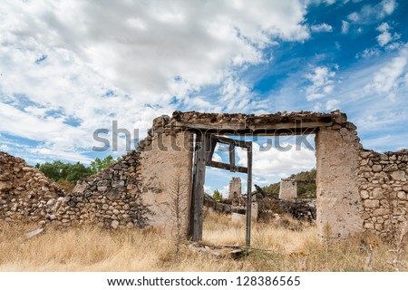 Ancient door in a stone wall, entrance to an old house