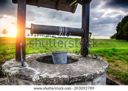 Ancient draw-well in European village  Stock photo ©