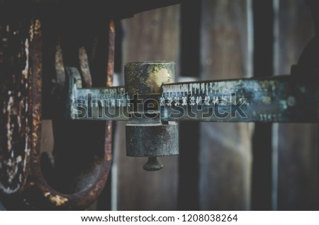 Ancient Eastern Scale Old weight balance made of metal Weighing by hand with weighted pendulum Vintage Coloring Process