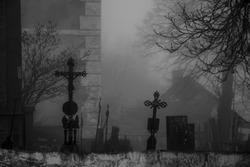 Ancient eerie graveyard in the fog