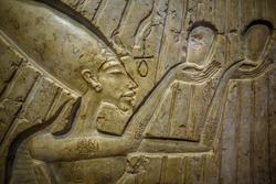 Ancient Egypt stella. Pharaoh Akhenaten & Nefertiti with three princesses worshiping for god Atenu. 16 century BC. Colored limestone. Egypt