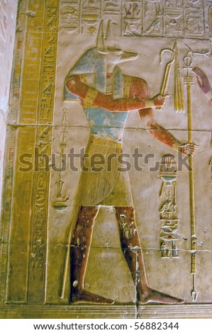Ancient Egyptian god Anubis Depicted with the head of a jackal, Anubis is the god of mummification.  Temple to Osiris at Abydos, Egypt.