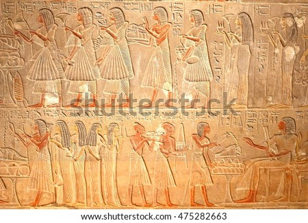 Ancient Egyptian hieroglyphics, stone carving reliefs with elegant women, historic Egypt #475282663
