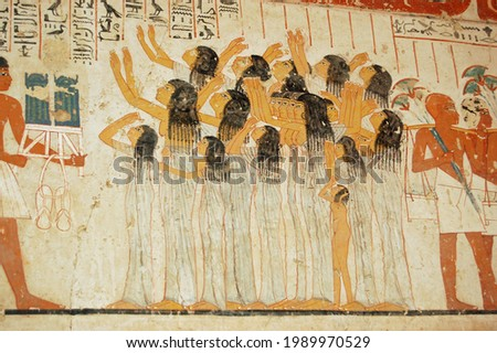 Ancient Egyptian mural showing women mourning at a funeral procession.  Tomb of the ancient Egyptian Vizier Ramose in the Sheikh Abd el-Qurna, part of the Theban Necropolis. Stock photo ©