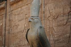 Ancient egyptian statue of falcon god Horus at the Temple of Edfu. Egypt
