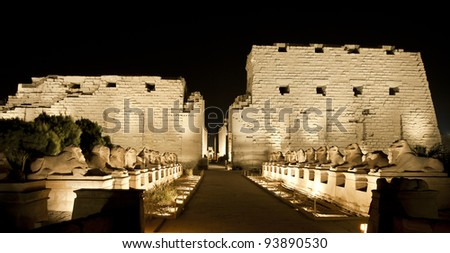 Ancient egyptian temple of Karnak in Luxor lit up at night during the sound and light show