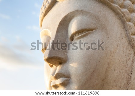 Ancient Face of a stone statue of Buddha #111619898