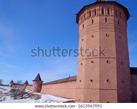 Ancient fortress, red tower, wooden architecture. Historical monuments