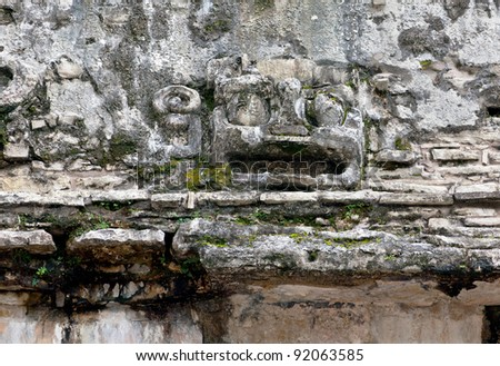 Ancient fragment of bas-relief on the ruins in the Palenque, Mexico