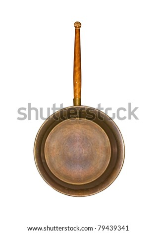Ancient frying pan with the wooden handle