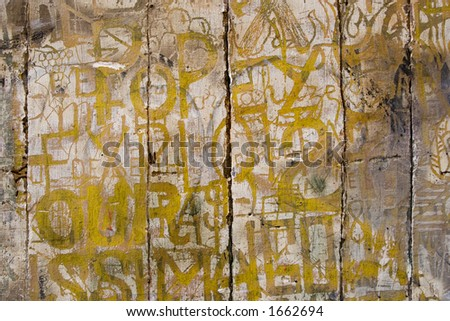 Ancient graffitti etched into the crumbling wood and plaster of historic timbered building in Rouen, France.
