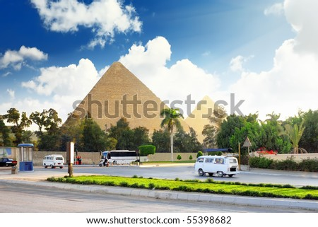 Ancient Great Pyramids and present day of Giza town,suburb of Cairo city.  Egypt. - stock photo