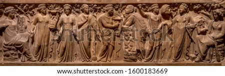 Ancient Greece bas-relief showing scene with women