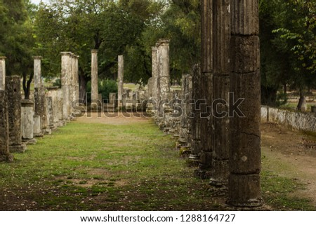 ancient Greece stone column alley way ruins of destroyed city, European heritage touristic site for tourists and sightseeing in park outdoor environment