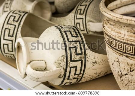 Ancient Greek amphoras on shelf
