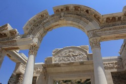 Ancient greek architectural arch and columns made of marble in ancient city of Ephesus - archaeological heritage UNESCO site near Selçuk, Kusadasi, Izmir Province, Anatolia, Turkey