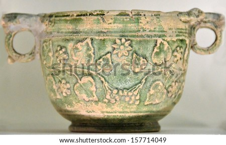 Ancient greek bowl with grape and vine decorations and green glaize, probably used for wine. From the classical age (5th-6th century BC)