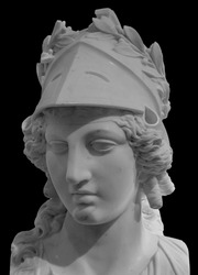 Ancient Greek goddess Athena Pallas statue isolated on black. Marble woman head in helmet sculpture.