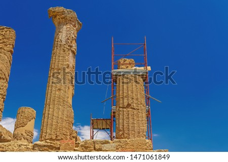 Ancient Greek Roman temple restoration scaffoldings. Day view of metal construction to support repair and preservation at Temple of Juno - Hera in Agrigento Sicily Italy archaeological site. #1471061849