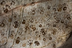 Ancient hand print mysterious on stone wall  in Tham Muang On cave at limestone mountain situated of Mae On for thai people and foreign travelers travel visit in San Kamphaeng at Chiang Mai, Thailand