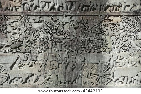 Ancient Harvest Festival on Relief in Angkor Wat Temple Wall, Cambodia