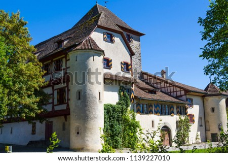 Ancient Hegi castle in the town Winterthur, Switzerland. General view, outside on a blue sky background in a summer day. Tourist attraction, tourist destination. #1139227010