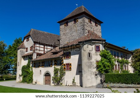 Ancient Hegi castle in the town Winterthur, Switzerland. General view, outside on a blue sky background in a summer day. Tourist attraction, tourist destination. #1139227025