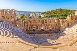 Ancient herodes atticus theater amphitheater of Acropolis of Athens, landmark of Greece and city panorama