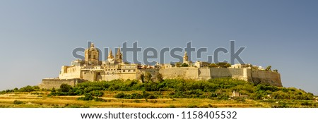 Ancient hilltop fortified ancient village of Mdina, Malta in a sunny summer day.\nHDR photo of Mdina, Malta.