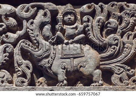 ancient hindu god sitting on...