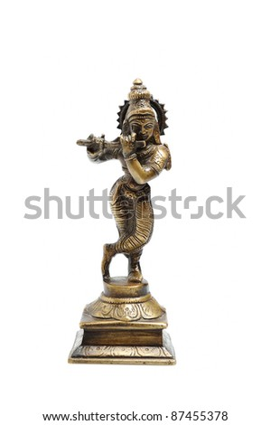 Ancient indian figure of Krishna God isolated