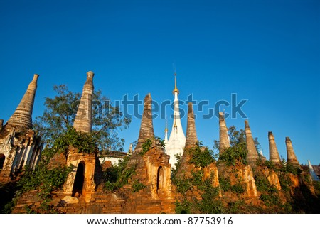 Ancient Inn Thein Paya, Indein, Shan state, Burma. Weather-beaten buddhistic zedi constructed in 17th and 18th century damaged by earthquake in 1975