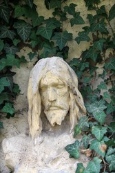 Ancient Jesus on a old Prague Cemetery, Czech Republic