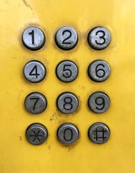Ancient keypad,signs,symbols and numbers button on the old public telephoneof old public phone