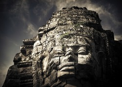 Ancient Khmer architecture. Huge carved Buddha faces of Bayon temple at Angkor Wat complex, Siem Reap, Cambodia