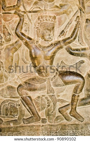 Ancient Khmer bas relief of Kauravaa soldier holding spear in the Battle of Kurukshetra.  Wall of Angkor Wat Temple, Siem Reap, Cambodia.