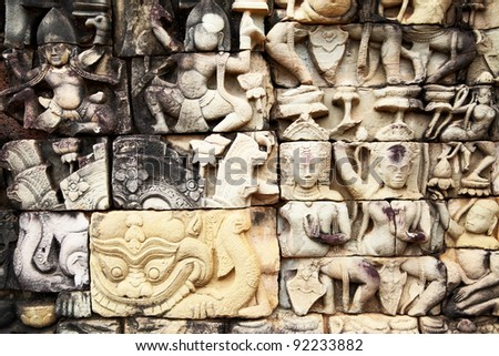 Ancient khmer stone carving in Angkor Thom, Cambodia