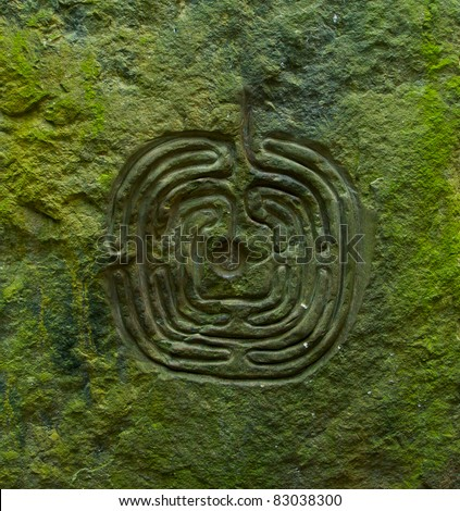 Ancient labyrinth cut in stony wall to help you find a way from maze