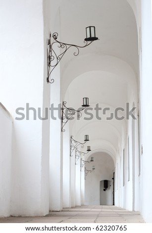 Ancient lanterns on a white corridor wall