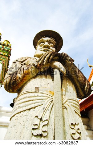 Ancient lord stone statue Asian Chinese style art in Thailand Buddha Temple