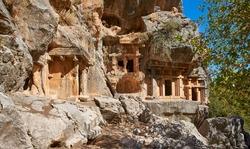 Ancient Lycian rock tombs in Pinara, Fethiye, Turkey