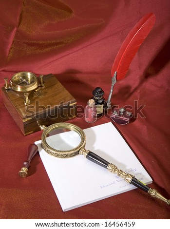 Ancient magnifier a feather ink and a zoom on a red background