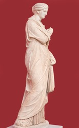 Ancient marble female funerary statue from Aigion, Peloponnese, Greece, dating from about 300 B.C. The female figure is depicted in the type of the Small Herculaneum woman.